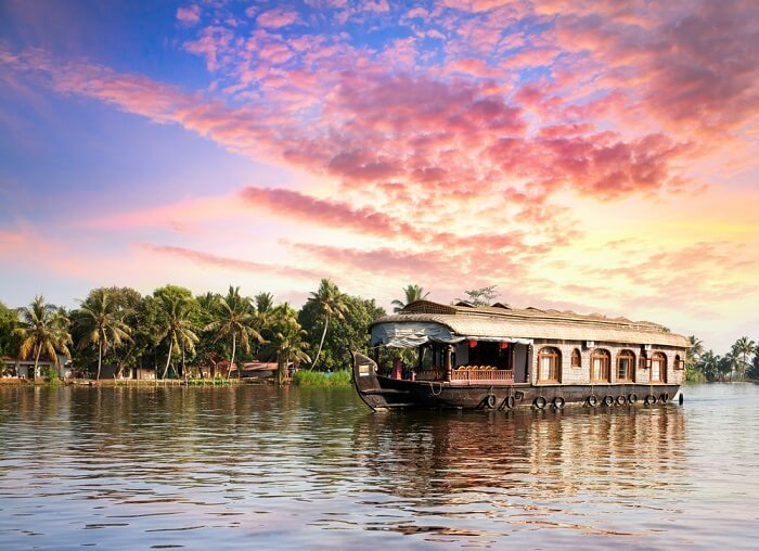A houseboats floating in the backwaters of Alleppey at dusk
